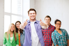 Student with group of students at school Royalty Free Stock Photography