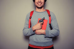 Student with gun and book Royalty Free Stock Photos