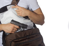 Student with gun. Student hides gun in a bag. Crime Royalty Free Stock Image