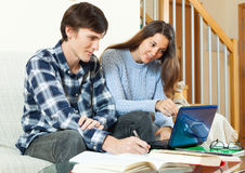 Student guy with girl preparing for session with electronic book Royalty Free Stock Image
