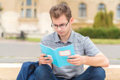 Student guy studying in the park Stock Image