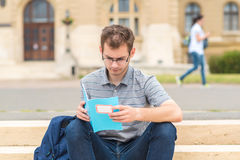 Student guy studying in the park Stock Images