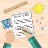 Student hand fills examination quiz paper. School exam test results. wooden school desk with pins, calculator. vector illustration in flat design Royalty Free Stock Image