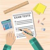 Student hand fills examination quiz paper Royalty Free Stock Image