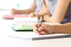 Student hand taking notes in a classroom Stock Photos