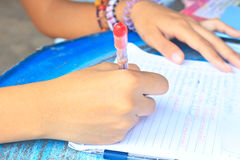 Student hand writing on paper Royalty Free Stock Photos