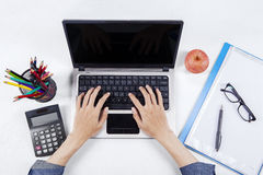 Student hands use laptop on desk Stock Photo