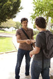 Student handshake. Happy young student giving a handshake to his classmate (selective focus Stock Image