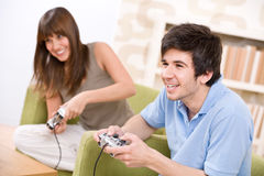 Student - happy teenagers play video game Royalty Free Stock Image