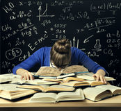 Student Hard Study, Tired Bored Woman Read Books over Blackboard. Math Formulas, Difficult Education Stock Photography