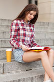 Student having a coffee break Royalty Free Stock Images