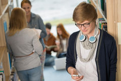 Student with headphones in college library Royalty Free Stock Photography
