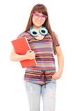 Student with headphones holding a notebook Stock Photography