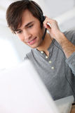 Student with headset on e-learning course Stock Photos