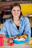 Student with healthy lunchbox. Student sitting in the class room with a healthy lunch in front of her Stock Images