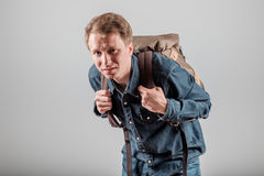 Student with a heavy backpack. The student with a heavy backpack. Tired of walking. Tired tourist from long walking royalty free stock photos