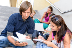 Student helping his colleague with school work Royalty Free Stock Images