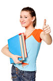 Student with her books in hand show thumb-up Royalty Free Stock Image