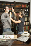 Student High Fiving - Vertical Royalty Free Stock Photography
