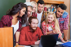 Student High School Group With Professor Using Laptop Computer Sitting At Desk, Young People Teacher Discuss. Communicate University Classroom Royalty Free Stock Image
