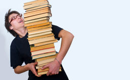 The student and his mountain textbooks Stock Image