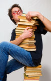 The student and his mountain textbooks Stock Photo