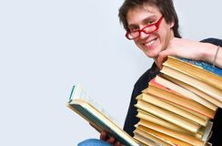 The student and his mountain textbooks Royalty Free Stock Photos