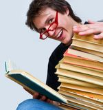 The student and his textbooks Royalty Free Stock Photography