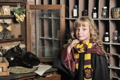 Student of Hogwarts school of magic. Blonde girl student in gown stock photo