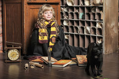 Student of Hogwarts school of magic. Blonde girl student in gown stock photos