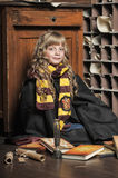 Student of Hogwarts school of magic. Blonde girl student in gown stock photography