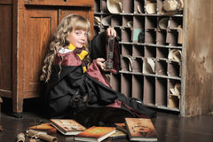 Student of Hogwarts school of magic. Blonde girl student in gown stock images
