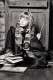 Student of Hogwarts school of magic. Blonde girl student in gown royalty free stock photo