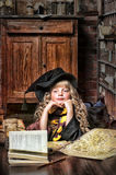 Student of Hogwarts school of magic. Blonde girl student in gown stock image