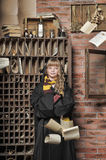 Student of Hogwarts school of magic. Blonde girl student in gown royalty free stock images