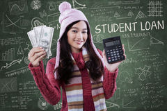 Student hold money and calculator Royalty Free Stock Image
