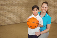 Student holding basketball with teacher Royalty Free Stock Photography