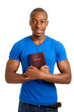 Student holding a bible showing commitment Royalty Free Stock Photos