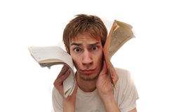 Student holding blank lined paper to face Stock Photography