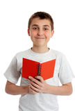 Student holding book in both hands Royalty Free Stock Images