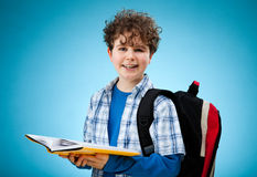 Student holding books Stock Images
