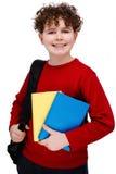 Student holding books Stock Image