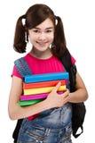 Student holding books Stock Photo
