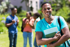 Student holding books. Happy male african college student holding books Stock Photography