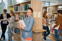 Student holding books in library Stock Photography