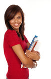 Student holding books smiling Royalty Free Stock Photography