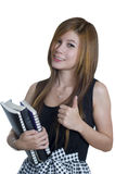 Student holding books with thumbs up Stock Photo