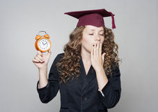 Student holding clock in hands Stock Photo