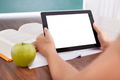 Student holding digital tablet Stock Photo