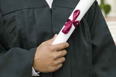 Student Holding Diploma On Graduation Day Stock Images